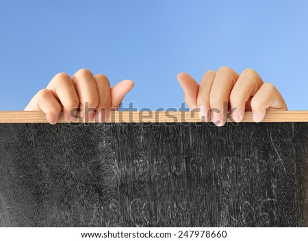 man holding blank chalkboard in the hand  - stock photo