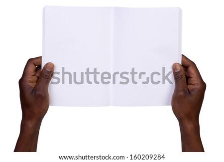 Man holding blank notebook isolated on white background - stock photo
