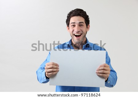 Man holding blank paper with  happy face - stock photo
