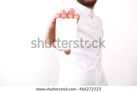 Man holding blank white business card with shallow dof, isolated on white background