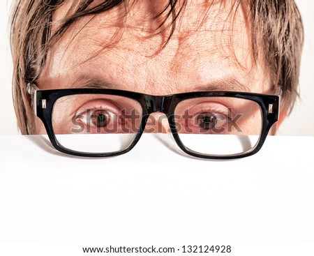 Man holding blank white paper over his face - stock photo