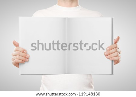 man holding book on white background
