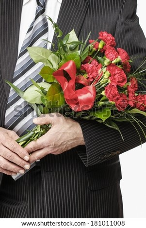 Man holding bouquet of red carnations