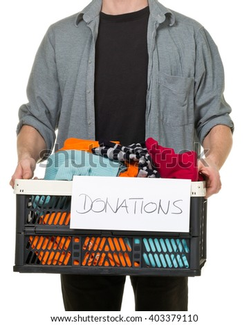 Man holding box with clothing donations over white background  - stock photo