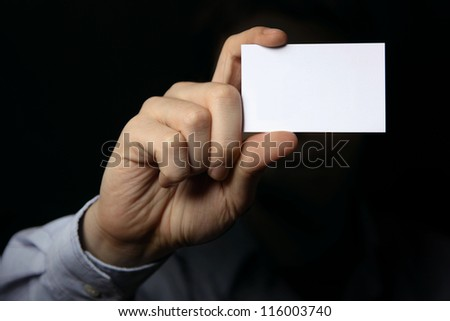 Man holding business card. Close up shot - stock photo