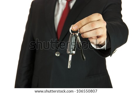 Man holding car key in his hand on white background