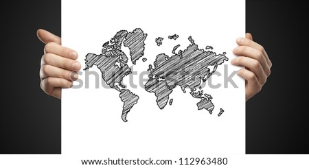 man holding card with drawing map on a black background - stock photo
