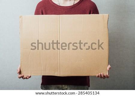 man holding cardboard - stock photo