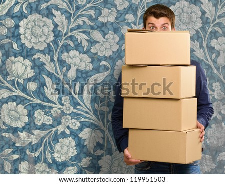 Man holding cardboard boxes, indoor