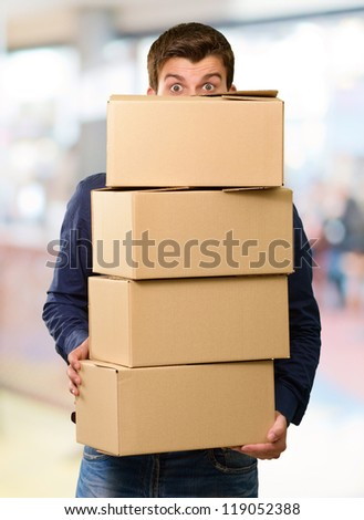 Man holding cardboard boxes, outdoor - stock photo