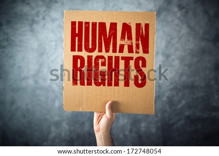 Man holding cardboard paper with HUMAN RIGHTS title, conceptual image - stock photo