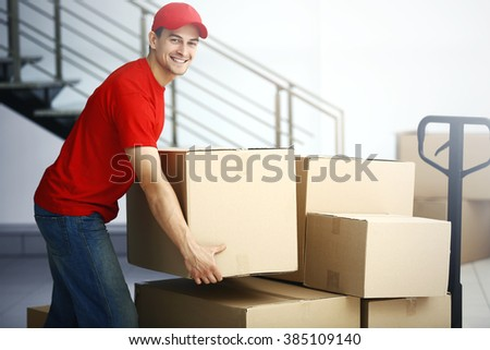 Man holding carton box in the room, close up - stock photo