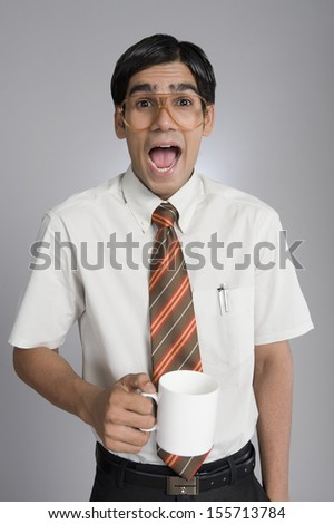 Man holding coffee cup and shouting