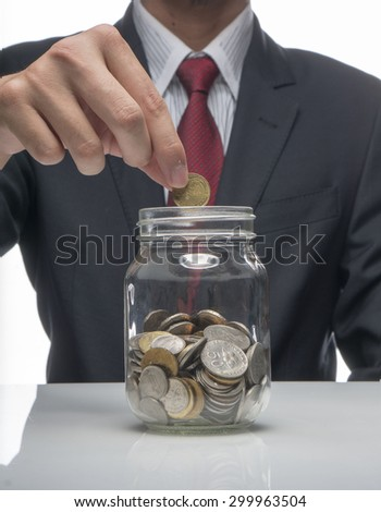 Man holding coins in Ringgit Currency (Saving Concept) - stock photo