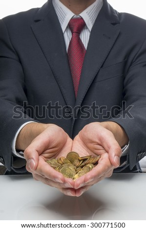 Man holding coins in Ringgit Currency (Saving Concept)