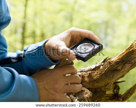 man holding compass - stock photo