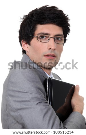 Man holding computer in his arms - stock photo