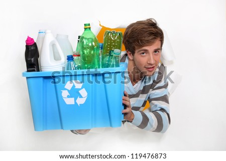 Man holding crate of bottles to be recycled