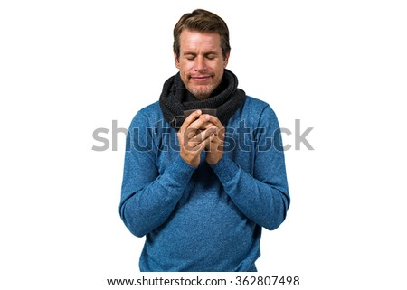 Man holding cup with eyes closed against white background - stock photo