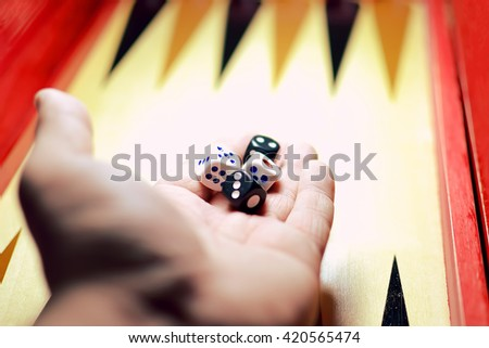 Man holding dice in his hands to win - stock photo