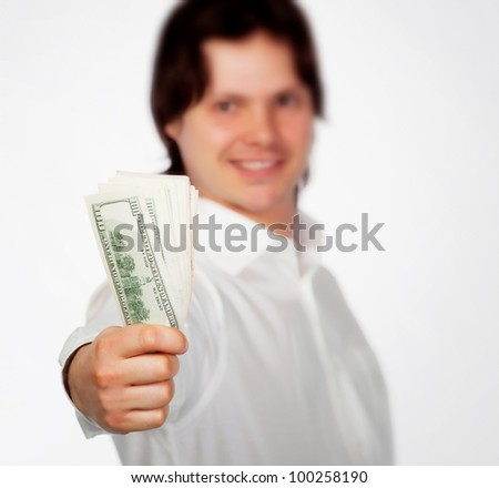 Man holding dollars in hand isolared on white - stock photo