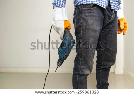 Man holding drilling tools - stock photo