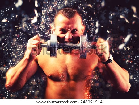 Man holding dumbbell in his hand - stock photo