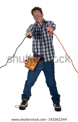 Man holding electrical clamps - stock photo