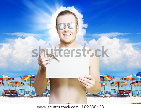 Man holding empty copyspace banner at tropical resort in vacation paradise , photo taken Phi Phi Island Thailand - stock photo