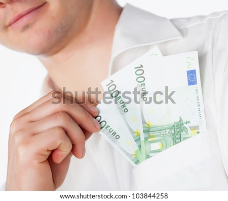 Man holding euro currency in pocket