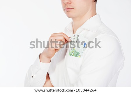 Man holding euro currency in pocket - stock photo