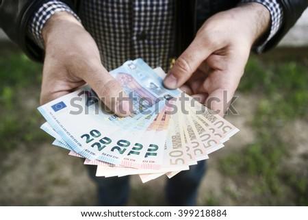 man holding euros - stock photo