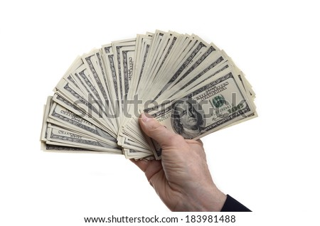 man holding fanned 100 dollar bills isolated on a white background  - stock photo