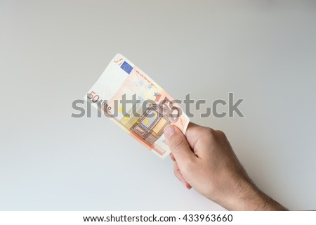 Man holding fifty  Euro banknote in his hands