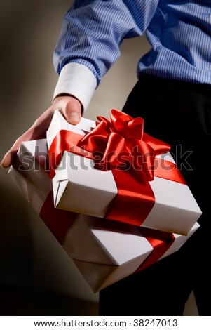 Man holding fine wrapped gift box