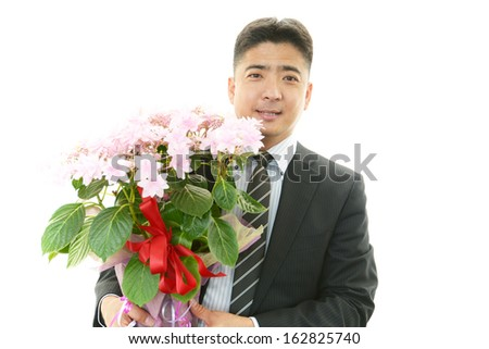 Man holding flower pot