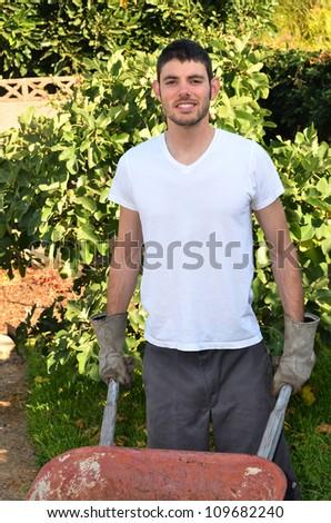 Man holding garden tools/Man working in Garden/Man working in his garden during the early morning - stock photo
