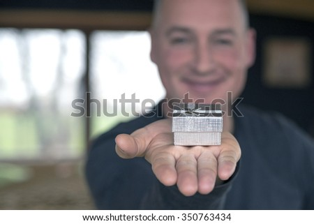 man holding gift box - stock photo
