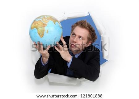Man holding globe - stock photo