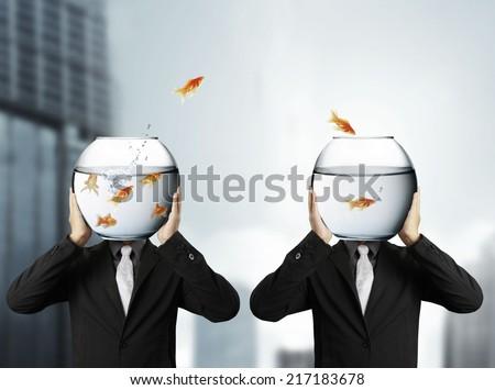 man holding goldfish - stock photo