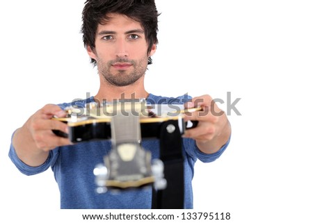 man holding guitar