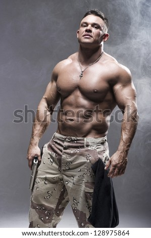 Man holding gun - stock photo
