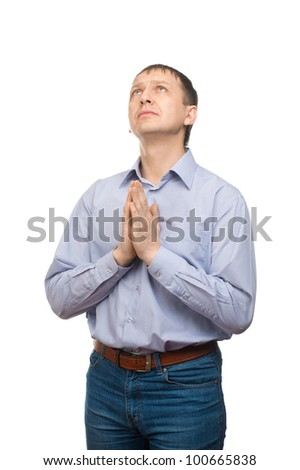 Man holding hands together and praying. Isolated on white background - stock photo