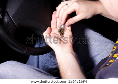 man holding hashish in the car - stock photo