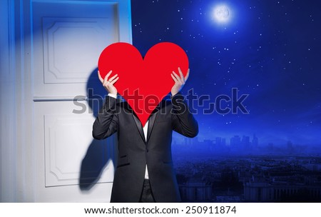 Man holding heart symbol - stock photo