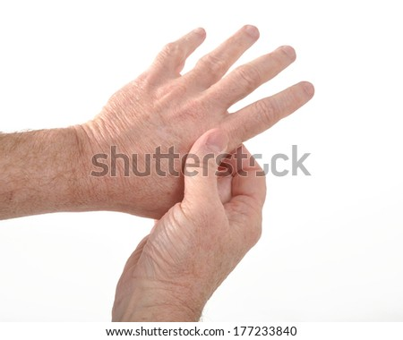 Man holding his aching thumb - stock photo