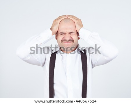 man holding his head pain. Closed eyes in pain. Headache. Migraine. - stock photo