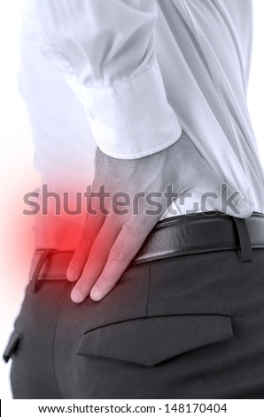 Man holding his painful lower back. - stock photo