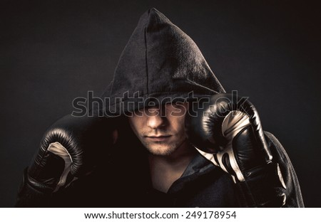 man holding his position and looking at the camera - stock photo