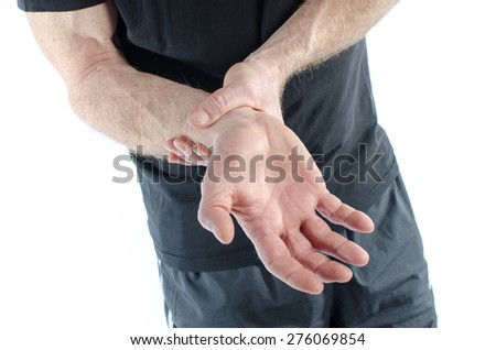 Man holding his sore wrist